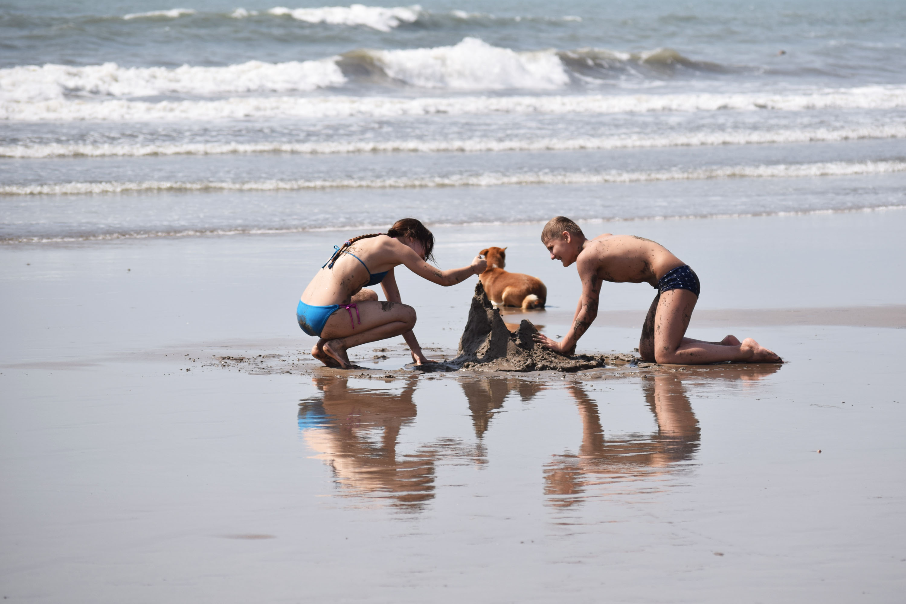 childrens playing at beach, goa, free indian travel and stock photos