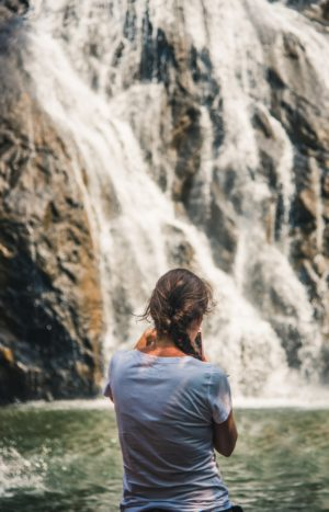 girl looking at waterfalls, dudhsagar waterfalls, goa free indian travel and stock photos